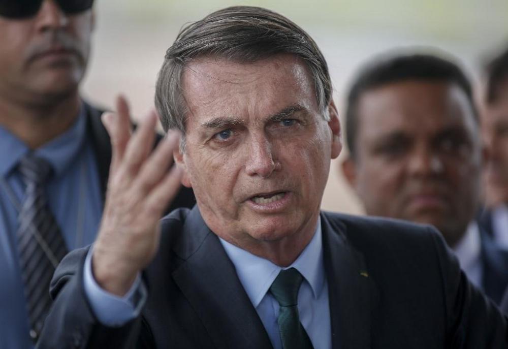 Bolsonaro irá se reunir com Guedes para definir aumento no salário mínimo | Foto: Sergio Lima / AFP
