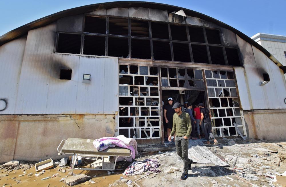 Número de mortos em incêndio em hospital do Iraque aumenta para 64 | Foto: Asaad Niazi / AFP